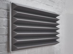 Premium sound absorber with triangular profile