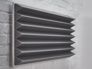 Sound absorber with triangular profile